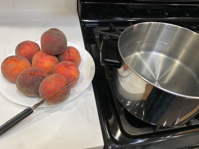 Cut the peaches in half