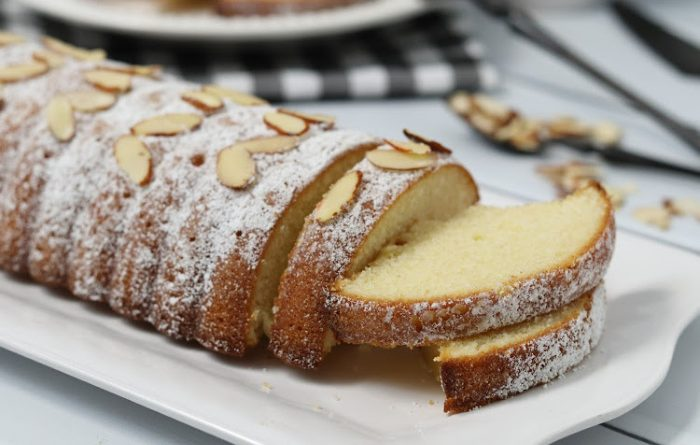 Baked Almond Cake On A White Plate