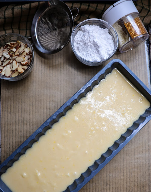 Pouring the almond cake batter into the pan