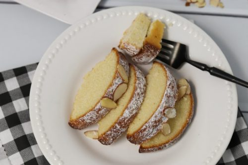 Slices of Almond Cake on a white plate with a fork