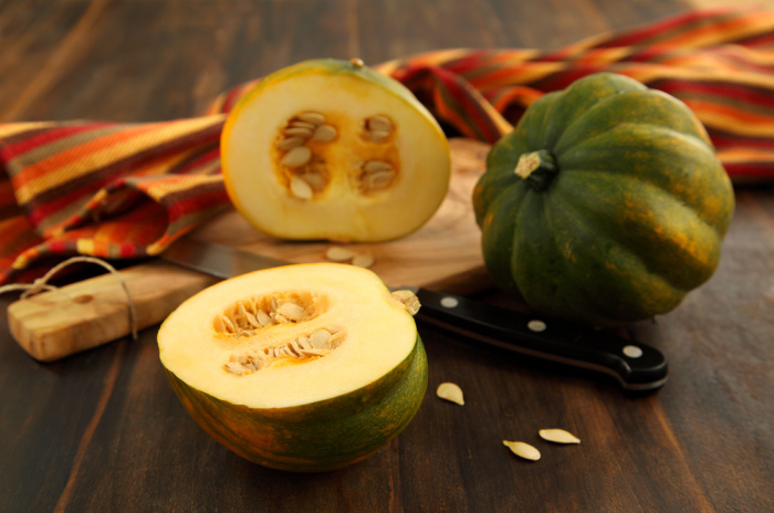 Acorn squash on a wooden board