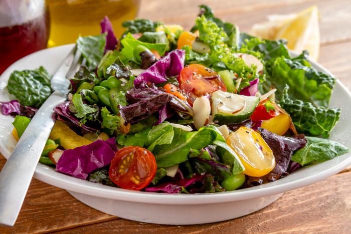 Kale salad on a white bowl