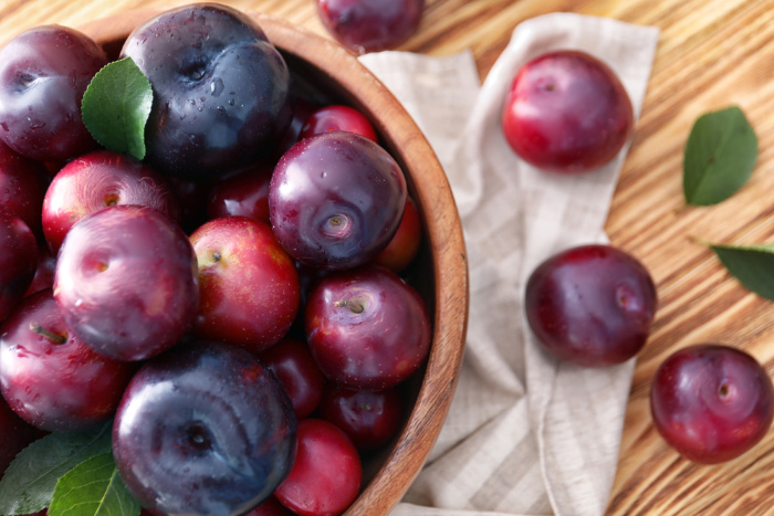 Fresh Plums on a Table