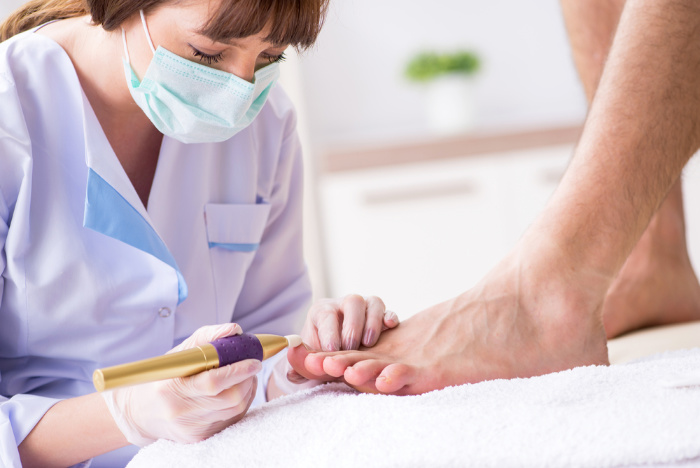 Podiatrist Treating Patient