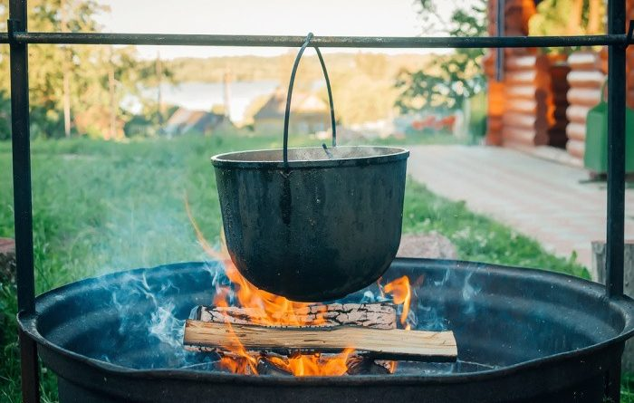Cooking Over A Fire Outdoors