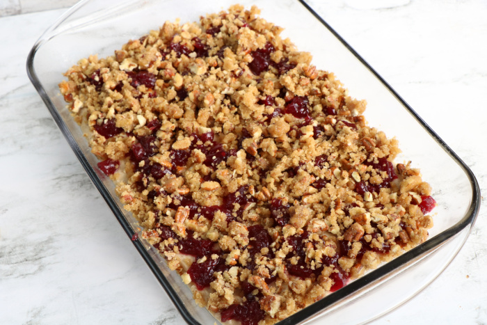 Spread the crumble topping on the batter