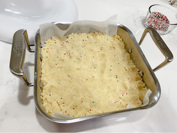 Fold in Sprinkles and pat into prepared pan