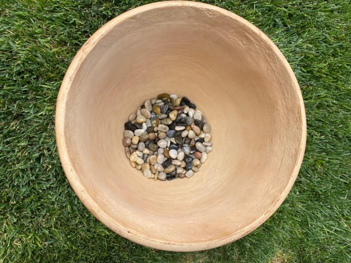Fill pot with rocks