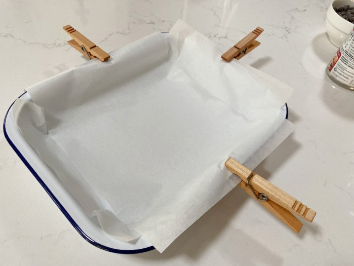 Line the pan with parchment paper