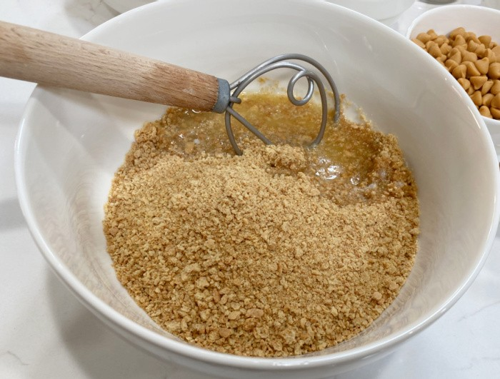 Add the butter with the graham crackers